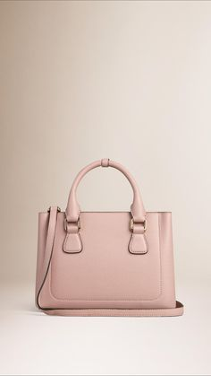 Burberry The Small Saddle Bag in Grainy Leather and Bonded Suede | Pale Orchid | The Saddle Bag in grainy leather bonded to a suede lining in a contrasting colour. With utilitarian details, the Italian-made bag is inspired by military designs from the Burberry Heritage Archive. | $2,295