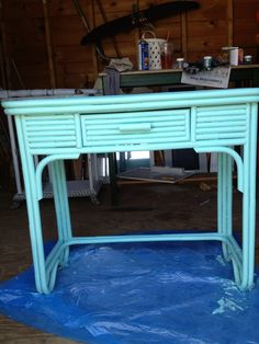 "Rattan table off craigslist. Looks just like the pieces from Maine cottage furniture! Amazing what paint can do:) benjamin Moore paint in "" Fun n games"""