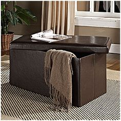 Brown Faux Leather Folding Storage Ottoman     from Big Lots