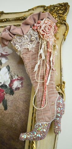 """Like how this """"stocking"""" is adorned with lace, ruffles, pearls, ribbons, and fabric rose!"""