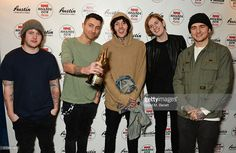 Lee Malia, Jordan Fish, Oliver Sykes, Matt Kean and Matthew Nicholls of Bring Me The Horizon, winners of the NME Innovation Award, pose in the Winners Room at the NME Awards with Austin, Texas, at the O2 Academy Brixton on February 17, 2016 in London, England.