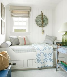coastal bedroom--love the bed and look for the loft.  Shabby shic table next to bed, etc.