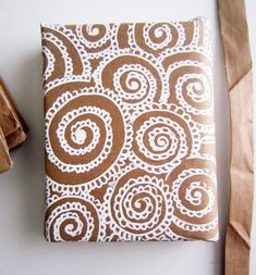 brown paper bags, correction pen, doodles = gift wrap :)