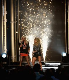 Miranda Lambert Photos Photos - Recording artists Miranda Lambert (L) and Carrie Underwood perform onstage during the 2014 Billboard Music Awards at the MGM Grand Garden Arena on May 18, 2014 in Las Vegas, Nevada. - 2014 Billboard Music Awards - Show