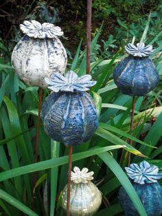 Make large - frog house and bird bath. Poppy seedheads, stoneware ceramics, handbuilt.: