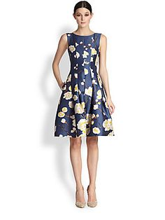 Oscar de la Renta Cherry Blossom Print Radzmir Dress, navy. Sleek, precisely constructed vertical seams give way to inverted pleats to create a feminine, full-skirted silhouette in lustrous printed radzmir.