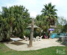 Check out this backyard ''private beach oasis,'' complete with tiki bar and landscaping!