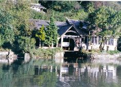 Oak boathouse on River Dart in South Devon. By Roderick James Architects