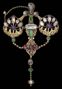 Brooch by John Paul Cooper, Arts and Crafts, 1908, of gold, ruby, moonstone, pearl, amethyst, chrysoprase (Museum of Fine Arts, Boston)