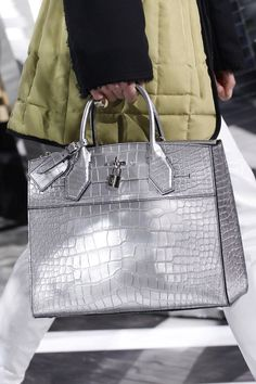 Louis Vuitton - We love this large metallic silver top handle bag with silver hardware - Fall 2016 Ready-to-Wear Fashion Show #details...x