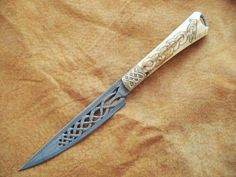 Viking themed knife made by Tiaan Burger. Damascus blade, bronze bolsters, antler handle