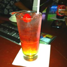 New favorite drink!!! It's called The Candy Shop. Sour apple pucker, watermelon vodka, sprite, and a splash of cranberry juice. Soooooo yummy!!!