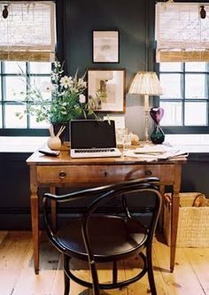 A little laptop station like this would be awesome, and completely unobtrusive in a living room.
