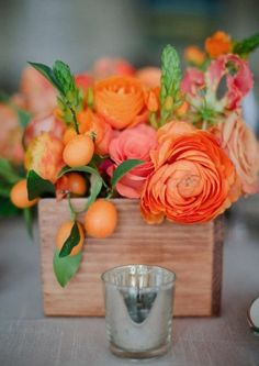 light peach citrus wedding centerpiece  / http://www.himisspuff.com/citrus-wedding-decor-ideas/9/