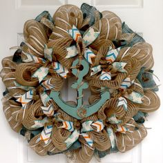 Anchors Away Nautical Handmade Deco Mesh Wreath. New, Full, Premium, large, handmade deco mesh nautical welcome wreath. A large, wood rustic turquoise anchor is decorated with real rope. The anchor rests on a bed of creamy burlap. Beautiful canvas ribbons with turquoise coral and canvas orange, grey and turquoise chevron ribbons surround the center ring. The outer ring is made of striped burlap and white deco mesh. Turquoise burlap and burlap/cream flex ribbons surround the exterior. The...