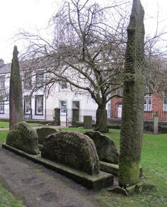 Hogback stones and two upright crosses at 'The Giant's Grave', St Andrew's Church, Penrith.