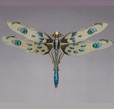 An Art Nouveau dragonfly brooch, by Louis Aucoc, French, circa 1900. Platinum, gold, enamel, diamond, emerald, ruby and horn.