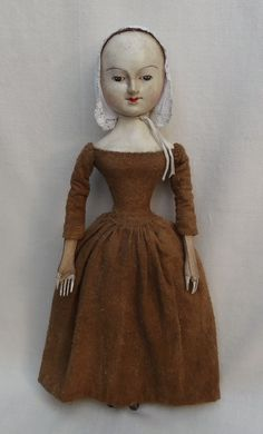 Very rare ca 1680 English carved wood doll with period costume and linen cap.