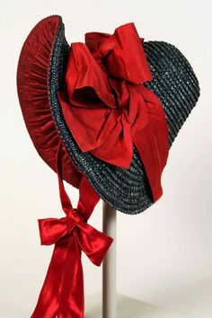 - Dark blue straw and red satin bonnet. Bonnets are the oldest hats style in history. It protects the face from the wind and sun. Keeps the hair away from the face. Vintage Dresses, Vintage Outfits, Vintage Fashion, Historical Costume, Historical Clothing, Mode Mori, Victorian Hats, Love Hat, Vintage Clothing