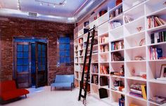 the brick and the wall covered bookcase...especially with it being white--great contrast