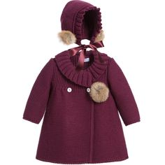 This Foque pram coat and hat set has a double-breasted button fastener and a ruffle collar. With a matching bonnet, baby girls will look adorable in the chunky knit, fur pom-poms and a satin ribbon which fastens under the chin.