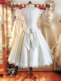 Joanne Fleming Design; ivory French lace and silk tea length wedding dress