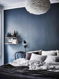 Modern blue Scandinavian bedroom in shades of grey. Modern blue Scandinavian bedroom in shades of grey. Blue Bedroom Walls, Blue Accent Walls, Blue Bedroom Decor, Bedroom Paint Colors, Bedroom Green, Blue Walls, Bedroom Ideas, Bedroom Alcove, Blue Bedrooms