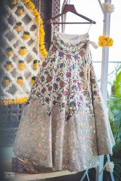 Bridal Lehengas - Shailin & Masoom | WedMeGood | Ivory and Pink Lehenga with Embroidered Flowers by Anamika Khanna  #wedmegood #indianbride #indianwedding #bridal #lehenga #ivory #floral