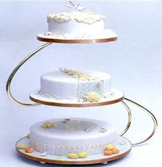 Modern cake stand, better than mom and dads cake stand with the fountain on the bottom and precious moments figures on top