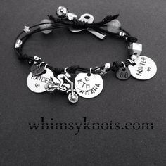I'm seeing black and pink vinyl cord, bike charm, skull charm, name charms for me and bike and the date I bought her