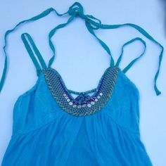 Free People Shirt Blue, beaded shirt by Free People. Size small. Fits like a S/M because it's flowy. Gently used. Free People Tops Tank Tops
