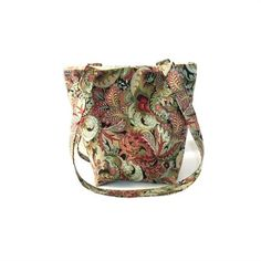 Paisley Purse, Floral Cloth Purse has Floral Paisley in Green, Red, Beige, Pink,  Blue.   This Handmade Handbag is fully lined in Beige, has 4 Green slip type pockets, 2 Handles that match the outside fabric  a Magnetic Snap Closure.   I use thick fleece interfacing, sandwiched between the lining  outer fabrics to add stability  durability to this fabric tote bag.   This is a smaller purse, mini tote bag. Perfect for teens  girls or for women who prefer to carry a smaller bag. Just big…