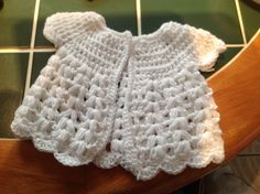 Free crochet baby cardigan pattern Here is a free pattern for you to try. I used a size 4 crochet hook and double knit wool for the red and the grey cardigans. Whilst I tried a super soft organic cotton for the white one. All design…