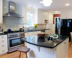 white kitchen cabinets subway tile backsplash Uba Tuba granite kitchen island