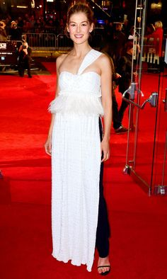 Rosamund Pike in a white one-shoulder Givenchy dress over black pants