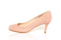 A stylish and comfortable wide fit court shoe in a soft pink kid suede. An ideal choice for Spring/Summer. Standard E Width Leather sole and insole Made in Spain Delivery 3-5 working days
