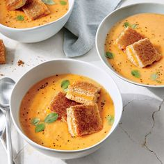 Tomato-Basil Soup with Grilled Cheese Croutons   A bit of 1/3-less-fat cream cheese adds rich body to our Tomato-Basil Soup, a fast weeknight meal that boasts three times the protein compared to common store-bought varieties.   Cooking Light