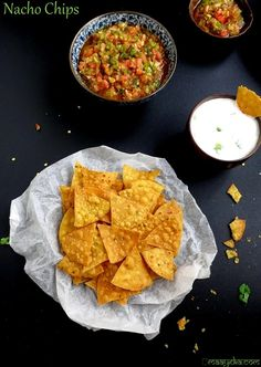 homemade tortilla chips Ingredients 3/4 cup Maize Flour / Makki Ka Atta 1/2 cup Refined Flour / Maida 1/3 tsp Red Chilli powder / Laal mirch powder 1/3 tsp Oregano  Salt / Namak  Cooking Oil to deep fry Servings: Units: Instructions In a big bowl add all the ingredients and mix well. Add Luke warm water to make a medium soft dough. Knead it for a minute. Make small size balls from the dough and keep aside. Roll them to make round size tortillas, thickness should be similar to a chapati or…