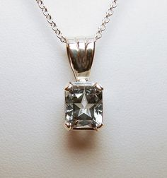 3.93cts Mason County Blue Topaz set in a sterling silver pendant.