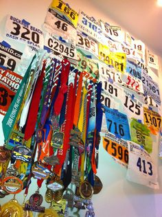 Display race medals and bibs. Lots of nails on a board for layering the medals.