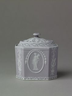 Circa 1803 Sugar box, Wedgwood collection - Lady Lever Art Gallery, Liverpool museums: A lidded sugar box made from lilac jasper with applied white jasper decoration, which has been inspired by classical art. The decoration would have been pressed into a mould and then applied. The lady of the house would serve tea to guests so sugar boxes, like this, were made to appeal to ladies.