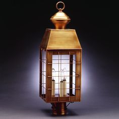 """A graceful counterpart to our Lynn fixtures, our Woodcliffe Collection is well suited to modern homes and carriage barns with their solid mansard tops and graceful H-rods. This 8353 (pictured in antique brass with (3) 60-watt candelabra sockets) is a square post mount fixture with a 3"""" fitter. It is available with either (1) 75-watt medium base socket and chimney or (3) 60-watt candelabra sockets and plastic cream sleeves. This fixture has been constructed with a door and tabs to make the…"""