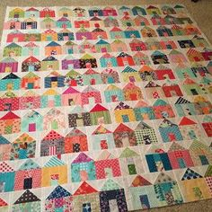"""Happy Tuesday! I simply love house blocks in quilts. In fact (hint, hint)...I may have something of the sort coming soon!     Original """"Village"""" quilt by Carrie Nelson I'll be sharing my house project"""