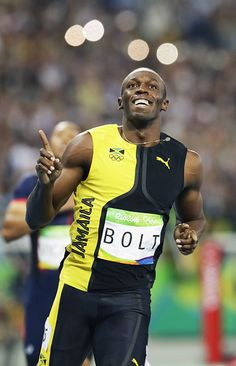 Jamaica's Usain Bolt celebrates after his victory in the men's 100 meters at the…