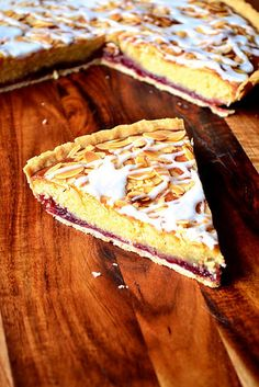 Cherry Bakewell Tart - a classic British tart with a storied history, flavoured with delicious cherry jam and a delicate almond-infused frangipane sponge. Cherry Bakewell Tart, Cherry Tart, Vegan Bakewell Tart, Cherry And Almond Cake, Tart Recipes, Sweet Recipes, Baking Recipes, Dessert Recipes, Sweets