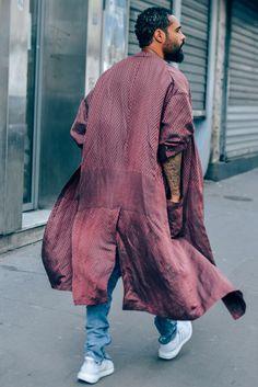 Burgundy Coat With Black Detailing, Denim With Split Cuffs And Nike Air Prestos. Jerry Lorenzo's Street Fashion, Man Behind Fear Of God.