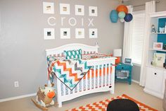 orange and turquoise baby boy nursery....I love the chevron pattern!