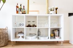 """Colie says their proudest DIY project is the bar cart. """"It was a simple update to an IKEA piece by adding legs, but it works great in the space and is extra kitchen storage!"""" Colie loves that she can swap out the feet to easily change the style to fit any space."""