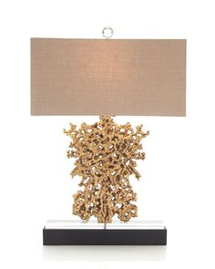 28H Gold Rush. Large golden nugget formation task lamp mounted on a double stack base of acrylic and black. Shade: (19x9.5)x(19x9.5)x9.5 Tan