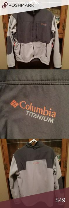 Mens Columbia Titanium Coat Used condition Columbia Titanium Coat  Grey and light grey color with orange Columbia logo.    MEN's Size XL  Full front zipper, chest zippered front pocket, zipper closure front side pockets, and slight collar. Really warm, mid-weight coat with side paracord vents.   One small blemish on the bottom front as shown in last picture.  Otherwise good used condition. Columbia Jackets & Coats